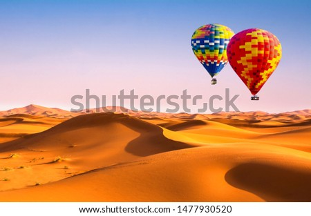 Travel concept. Amazing view of sand dunes with hot air balloons in the Sahara Desert. Location: Sahara Desert, Morocco. Artistic picture. Beauty world.