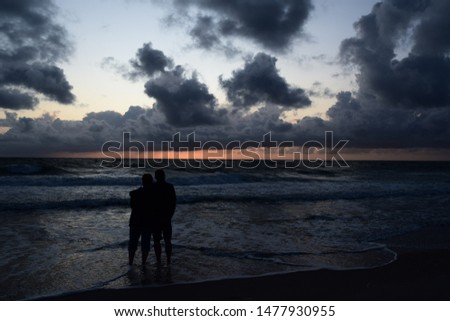 Silhouette of a pair at the sunset #1477930955