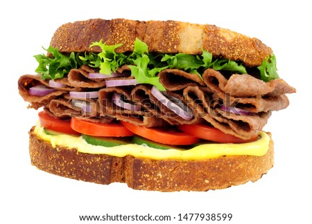 Steak and salad sandwich made with thin slices of reformed beef and pork meat isolated on a white background #1477938599