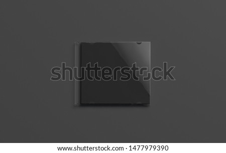 Blank black closed disk cover mockup, isolated on dark background, 3d rendering. Empty dvd packaging mock up, top view. Clear compact case for audio or video on darkness template.