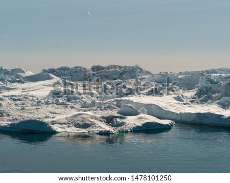 Global warming -Greenland Iceberg landscape of Ilulissat icefjord with giant icebergs. Icebergs from melting glacier. Arctic nature heavily affected by climate change #1478101250