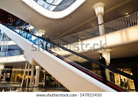 FRANKFURT, GERMANY - JUNE 29: inside view of the shopping mall MyZeil on June 29, 2013 in Frankfurt. MyZeil is a famous mall from architect Massimiliano Fuksas with the longest escalator in Germany. #147815450