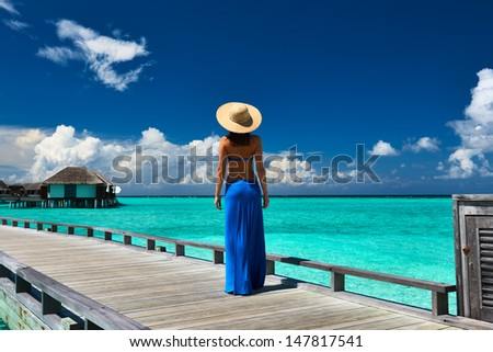 Woman on a tropical beach jetty at Maldives #147817541