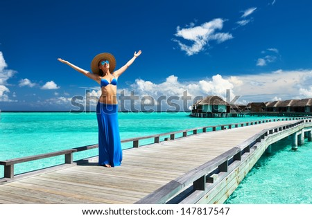 Woman on a tropical beach jetty at Maldives #147817547