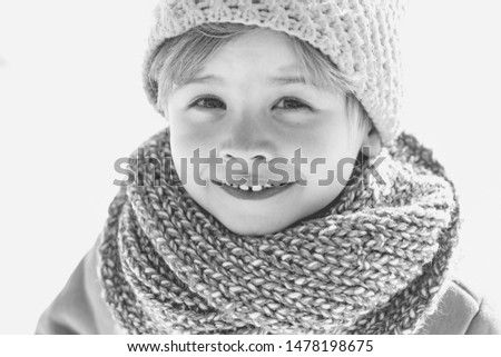 Happy christmas kid. Happy winter child snow background. Cute boy in winter clothes hat and scarf close up. Winter fashion. Black and white photo #1478198675
