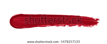 Lipstick smear smudge swatch isolated on white background. Creamy makeup texture. Red color cosmetic product brush stroke swipe sample #1478257133