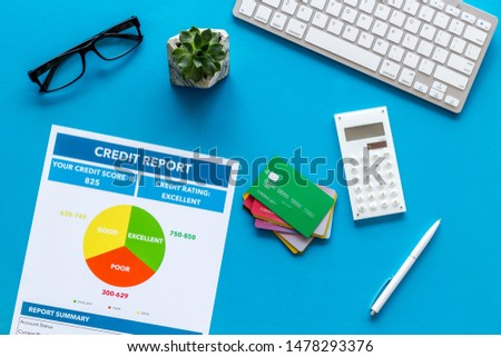 credit report with credit cards and keyboard on banker work place blue background top view #1478293376