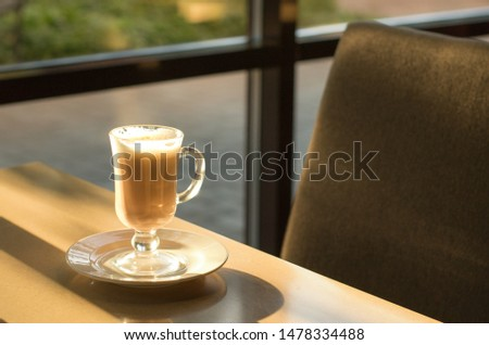 Morning coffee in a coffee shop with sunlight. Good morning concept