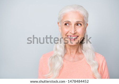 Close-up photo of pretty friendly kind winsome old lady making a decision looking to the side isolated grey background #1478484452