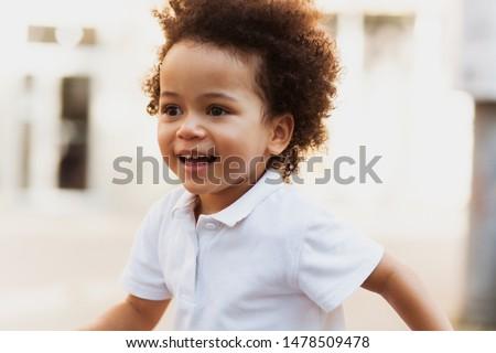 Cute little child having fun in the street #1478509478