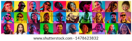 Beautiful male and female portrait on multicolored neon light backgroud. Smiling, surprised, screaming. Human emotions, facial expression. Creative collage made of different photos of 16 models. #1478623832