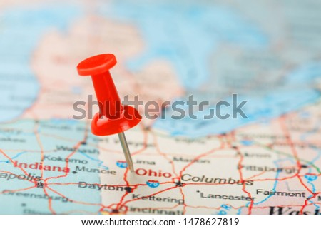 Red clerical needle on a map of USA, South Ohio and the capital Columbus. Close up map of South Ohio with red tack #1478627819