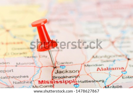 Red clerical needle on a map of USA, South Mississippi and the capital Jackson. Close up map of South Mississippi with red tack #1478627867