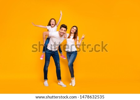Full length body size view of three nice attractive lovely stylish cheerful cheery optimistic person having fun weekend showing v-sign isolated over bright vivid shine yellow background
