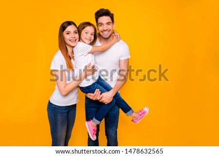 Portrait of three nice attractive charming cute lovely kind cheerful cheery funny carefree person cuddling embracing spending day life isolated over bright vivid shine yellow background
