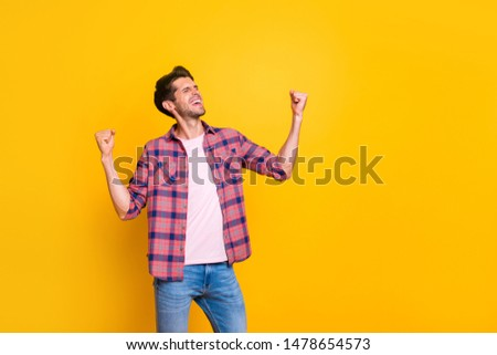 Photo of rejoicing overjoyed man having been promoted at work while isolated with vivid background #1478654573