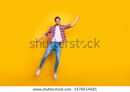 Full length body size photo of rejoicing overjoyed enjoying man wearing jeans denim pretending to be holding balloon and flying with it isolated with vivid background #1478654681