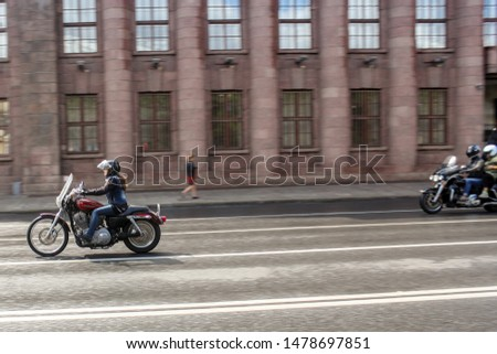 St. Petersburg, Russia - 3 August, 2019. Woman riding a motorcycle. The annual festival of bikers in St. Petersburg Harley Davidson. #1478697851