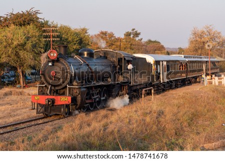 Victoria Falls, Zimbabwe - August 2 2019: Steam Train with Engine at Victoria Falls, pulled by Zambia Railways Steam locomotive 204. #1478741678