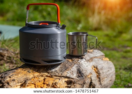 Kettle with a mug in a tourist camp. outdoor recreation in the Carpathian forest. #1478751467