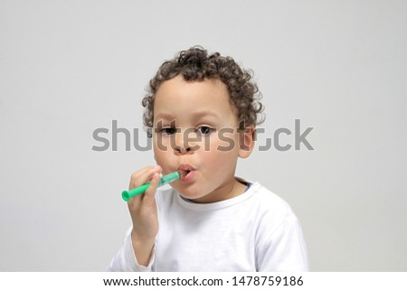 little boy taking medicine to make him feel better on white background stock image stock photo