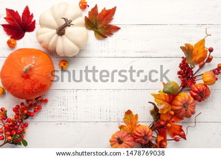 Festive autumn decor from pumpkins, berries and leaves on a white  wooden background. Concept of Thanksgiving day or Halloween. Flat lay autumn composition with copy space. #1478769038