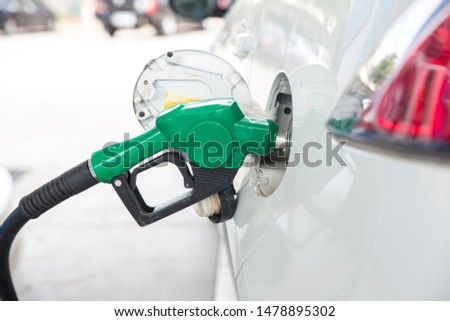 Refill and filling Oil Gas Fuel at station.Gas station - refueling.To fill the machine with fuel. Car fill with gasoline at a gas station. Gas station pump.  #1478895302