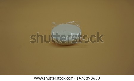 Ameniti of soap bar from the hands of a hotel on salmon background #1478898650
