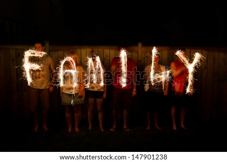 The word Family in sparklers time lapse photography