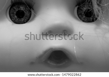 Horror shot: a scary doll on the floor,halloween night,horror doll in black and white picture style