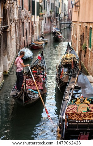 VENICE, ITALY-SEP 12, 2018: Venezia is a city in northeastern Italy and the capital of the Veneto region. It is situated on a group of 118 small islands that are separated by canals. #1479062423