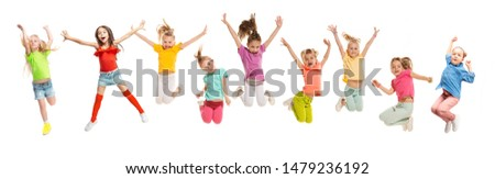 Group of elementary school kids or pupils jumping in colorful casual clothes jumping isolated on white studio background. Creative collage. Back to school, education, childhood concept. #1479236192