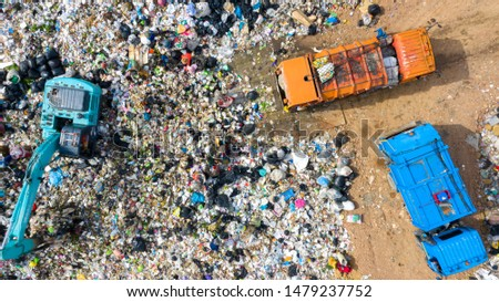Garbage pile in trash dump or open landfill, Trash trucks dump waste products polluting in an trash dump, Surface and subsurface water contamination, modern hydraulic. Aerial top view #1479237752