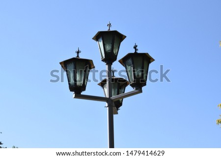 Street lamp against the blue sky #1479414629