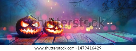 Jack O' Lanterns Glowing In Fantasy Night. Halloween Background #1479416429