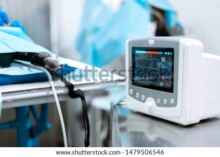 Heart rate monitor in hospital theater. Medical vital signs monitor instrument in a hospital on anesthesia surgery monitor.  ECG Patient Monitor. medical electronics. #1479506546