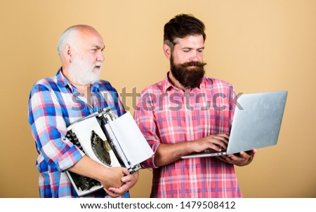 master service. youth vs old age. business approach. father and son. family generation. retro typewriter vs laptop. New technology. technology battle. Modern life. two bearded men. Vintage typewriter. #1479508412