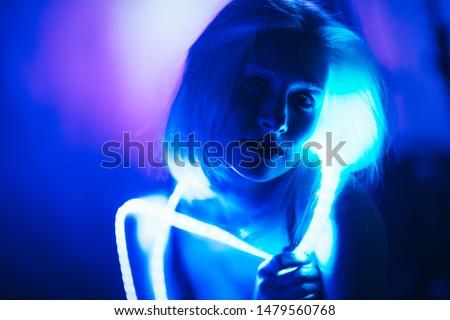 Portrait girl Strip Light LED tape on dark color background. #1479560768