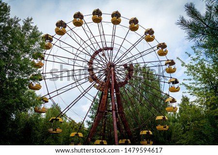 The abandoned Ferris wheel in the amusement park in Pripyat. Chernobyl nuclear power plant zone of alienation #1479594617
