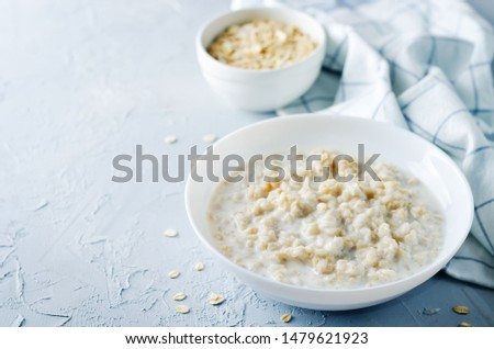 Oatmeal porridge with oats. toning. selective focus #1479621923
