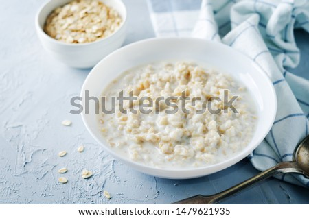 Oatmeal porridge with oats. toning. selective focus #1479621935
