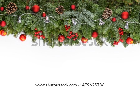 Christmas decorative background border with red bauble decorations, holly berries, spruce and pine cones #1479625736