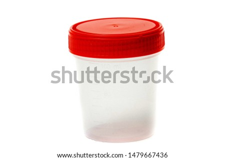 empty plastic urine jar isolated on red background. close up #1479667436