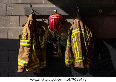 Firefighter protection clothes hanging in the firestation
