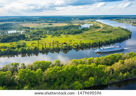 The Volga River, Russia. Tourist steamer floating on the Volga river channel, view from the quadcopter #1479690596