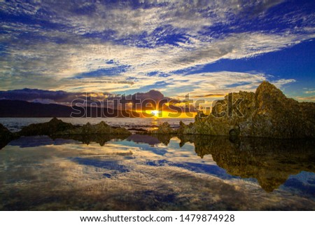 Amazing sunset reflected in tide pools on Oahu's North Shore #1479874928