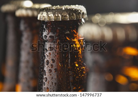 The group of wet bottles of beer #147996737