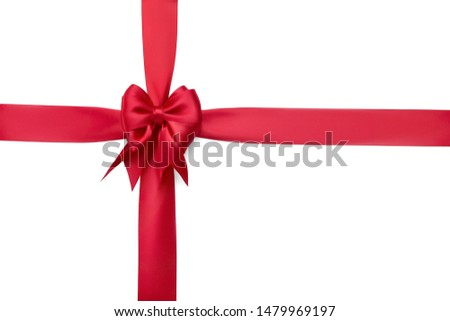 Beautiful red silk bow on a red ribbon tied with a cross isolated on white background #1479969197
