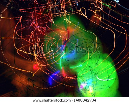 Light painting. Neon glow. Abstract blurred background. Colorful pattern. #1480042904