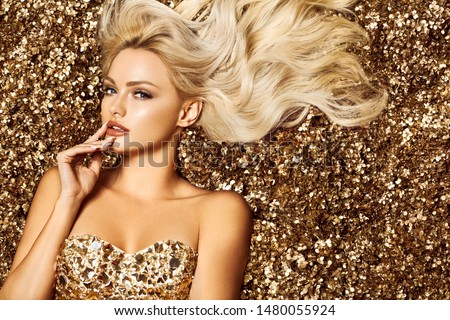 Beautiful hair Girl. Healthy Long Hair. Blonde woman in golden flowers garden, princes #1480055924